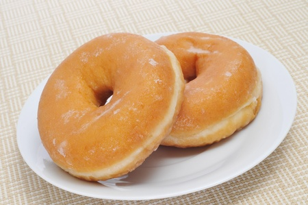 closeup of a plate with a pair of donuts photo