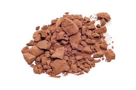 a pile of cocoa powder on a white background photo