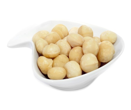 macadamia nut: a bowl with macadamia nuts on a white background