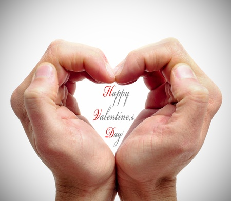 man hands forming a heart and the sentence happy valentines day Stock Photo - 11915365