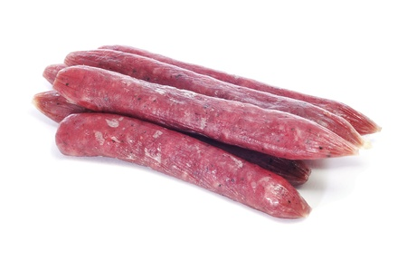 embutido: some fuet, spanish salami, on a white background Stock Photo