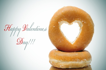 happy valentines day and a pile of donuts with a heart shaped hole photo