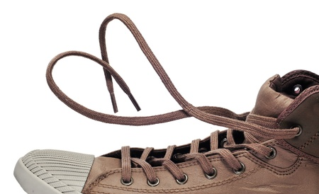 lace up: a sneaker boot with its shoelaces tied as a heart