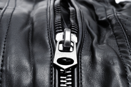 leatherette: closeup of a black leather jacket Stock Photo