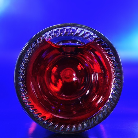 lambrusco: closeup of the bottom of a red sparkling wine bottle