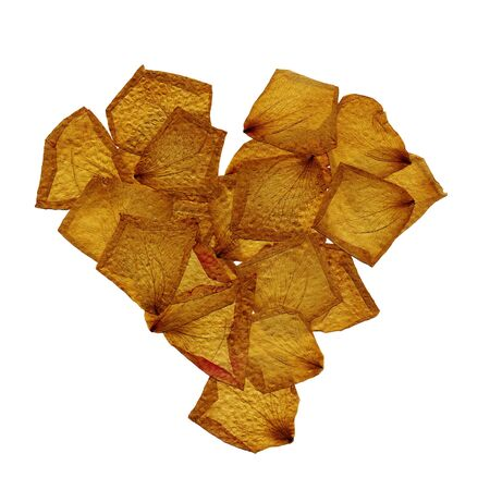 a pile of dried petals forming a heart shape on a white background photo