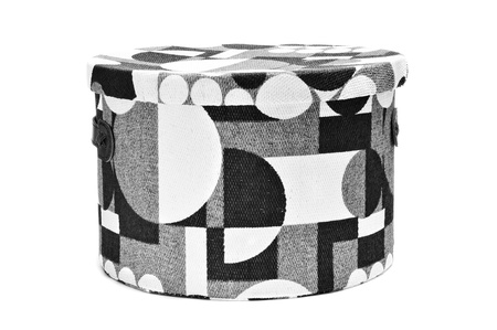 bandbox lined with a geometrical patterned fabric on white background photo