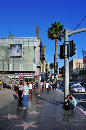 sidewalks: Los Angeles, USA - October 16, 2011: Hollywood Walk of Fame in Hollywood Boulevard in Los Angeles. Those more than 2,400 five-pointed stars attracts about 10 million visitors annually Editorial