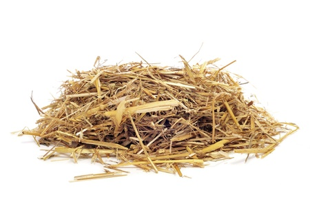 a straw: a pile of straw on a white background
