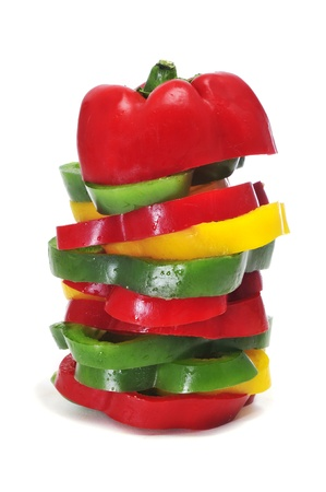 a stack of some slices of yellow, red and green peppers Stock Photo - 12062170