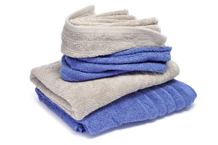 terrycloth: a pile of towels on a white background