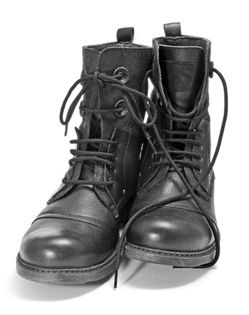 walk in closet: a pair of leather boots on a white background