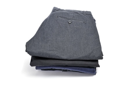 a pile of folded clothes on a white background Stock Photo - 12062180