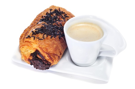 latte macchiato: continental breakfast: cup of coffee and croissant