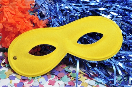 carnivale: carnival mask, tinsel and confetti of different colors Stock Photo
