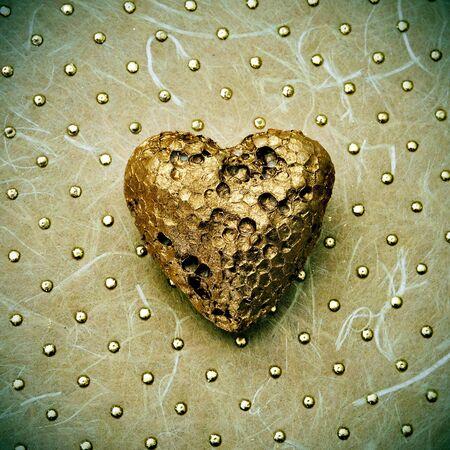 ocher: golden heart on a textured background Stock Photo