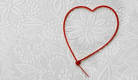 zip tie: heart-shaped zip tie on a patterned background