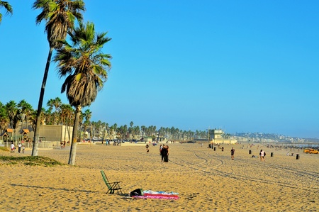 Venicee, USA - October 17, 2011: View of Venice Beach with its Pier in the background in Venice, US. Dozen of movies are filmed in the Venice Pier, a 1,310-foot (400 m) concrete structure