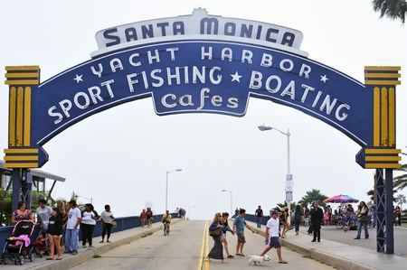 Santa Monica, USA - October 15, 2011: Famous entrance sign to Santa Monica Pier in Santa Monica, USA. There is an amusement park on the pier that is a famous tourist attraction