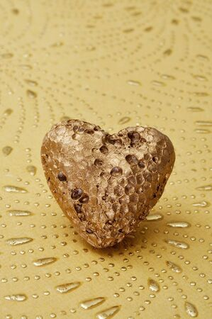 golden heart on a textured background photo