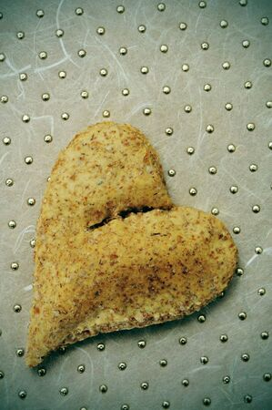 heart-shaped bread on a metallic background photo