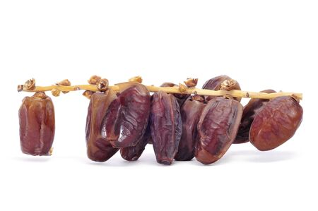dates fruit: a bunch of dried dates on a white background Stock Photo