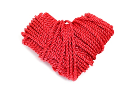 heart-shaped coil of rope on a white background photo