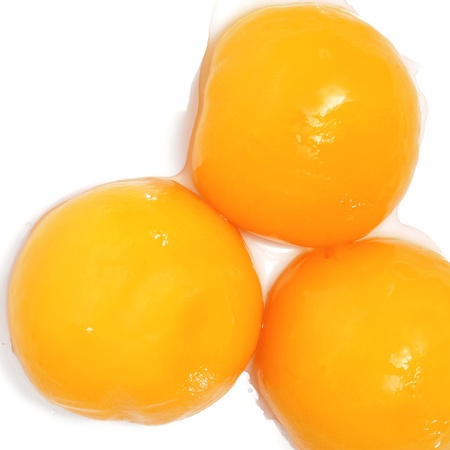 peach on syrup on a white background Stock Photo