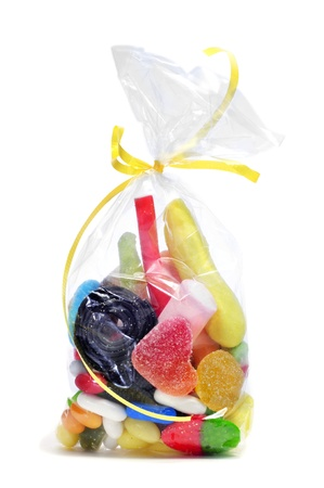 a bag with candies on a white background photo