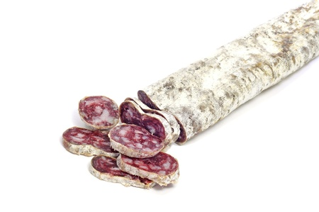 fuet, spanish salami, on a white background photo