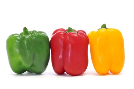 yellow, red and green peppers on a white background photo