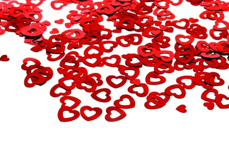 a pile of red hearts on a textured background photo