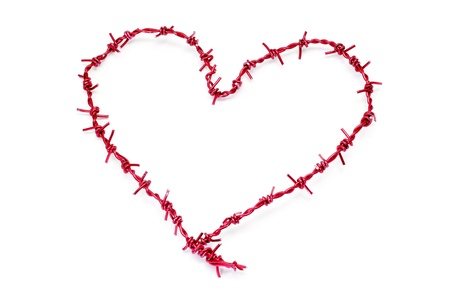 prisoner of love: heart-shaped barbed wire on a white background