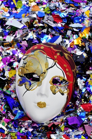 carnivale: venetian carnival mask on a shiny confetti background