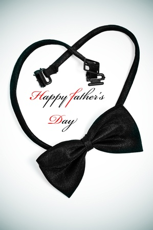a bow tie forming a heart and the sentence happy fathers day photo