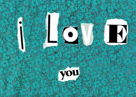 I love you written as in a ransom note on a patterned background photo