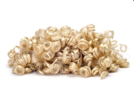 periwig: closeup of a curly blonde wig Stock Photo