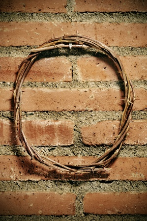 a representation of the Jesus Christ crown of thorns hanging on a brick wall photo