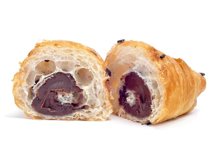 a croissant filled with chocolate on a white background photo
