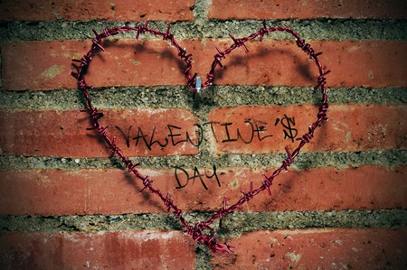 heart-shaped barbed wire and the sentence valentines day in graffiti style on a brick wall photo