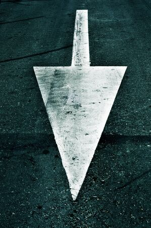 signaling: an arrow painted on the road