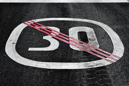end of speed limit sign painted on the road photo