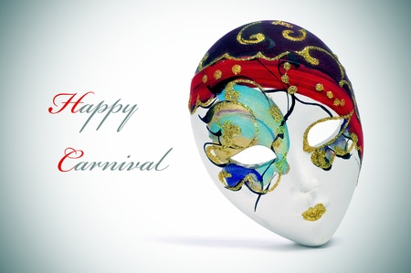 sentence: a venetian carnival mask and the sentence happy carnival Stock Photo