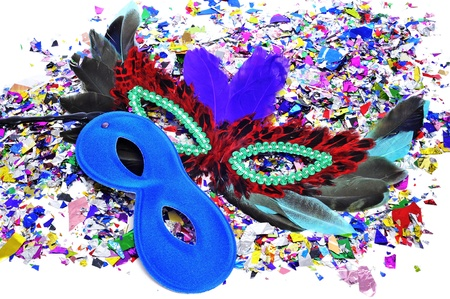 carnival masks and confetti of different colors photo
