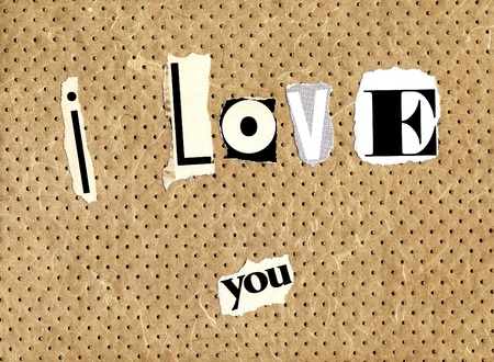 I love you written with newspaper and magazine cuts on a textured background photo