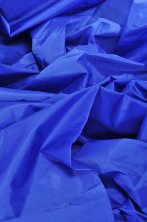 acrylic fiber: closeup of a blue satin fabric