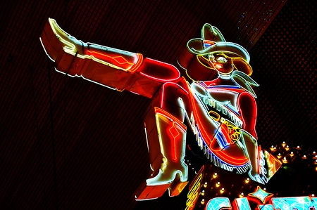 colorful light display: Las Vegas, US - October 13: Cowgirl neon sign in Las Vegas, US. The iconic sign of Glitter Gulch is placed in 20 East Fremont Street, in Downtown Las Vegas