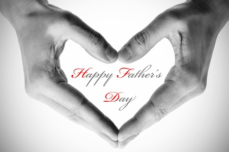 hands forming a heart and the sentence happy fathers day photo