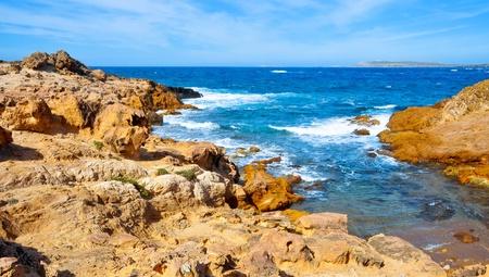 view of Binimela coast and Cap de Cavalleria in Menorca, Balearic Islands, Spain photo