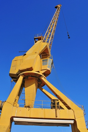 overhead crane: old gantry crane over the blue sky